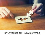 hands solving jigsaw puzzle... | Shutterstock . vector #662189965