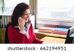 senior business woman sitting... | Shutterstock . vector #662194951