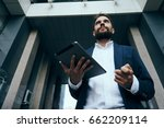 businessman with tablet ... | Shutterstock . vector #662209114