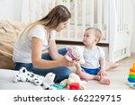 baby boy playing on floor at...   Shutterstock . vector #662229715