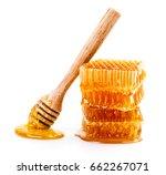 honeycomb with honey dipper... | Shutterstock . vector #662267071