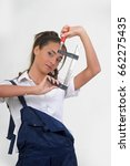 Small photo of Girl holding adjustable wrench
