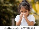 sick little asian girl wiping... | Shutterstock . vector #662302561