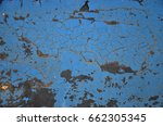 Small photo of Abstract blue background texture of a rough surface with a rusty brown spot