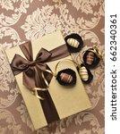 a golden gift box and arabic... | Shutterstock . vector #662340361