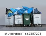 trashcans  overloaded with... | Shutterstock . vector #662357275