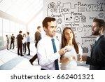 cheerful businesspeople having... | Shutterstock . vector #662401321