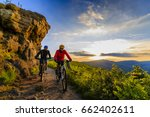 mountain biking women and man... | Shutterstock . vector #662402611
