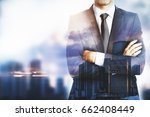 young businessman with folded... | Shutterstock . vector #662408449