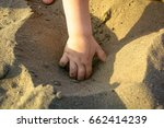 a small child dig a hole in the ... | Shutterstock . vector #662414239