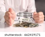 glass piggy  bank from  in hand | Shutterstock . vector #662419171