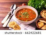Small photo of Traditional Maghreb, Moroccan and Algerian tomato soup Harira and ingredients. Served with figs. Ramadan food. Traditional Jewish cuisine