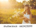 happy little girl on a sunset... | Shutterstock . vector #662425099