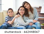 portrait of pretty young mother ... | Shutterstock . vector #662448067