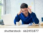stressed man in office looking...   Shutterstock . vector #662451877