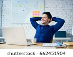 satisfied young man in office... | Shutterstock . vector #662451904