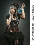 Small photo of Steampunk alchemist woman with potion in hand