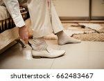 the groom wears shoes | Shutterstock . vector #662483467