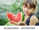 a child eats watermelon.... | Shutterstock . vector #662502364