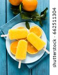 orange juice homemade popsicle. | Shutterstock . vector #662511304