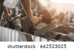young sportswoman lifting... | Shutterstock . vector #662523025