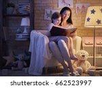 family reading bedtime. pretty... | Shutterstock . vector #662523997