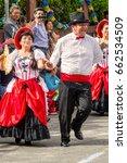 Small photo of Banos De Agua Santa, Ecuador - 29 November 2014: Group Of Latino People From Ecuador Dancing On The Streets Of Banos De Agua Santa, South America On 29 November 2014