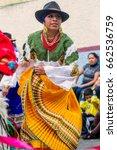Small photo of Banos De Agua Santa, Ecuador - 29 November 2014:Indigenous woman dancer is dancing on the streets of Banos de Agua Santa, South America, Christmas Holiday On November 29, 2014