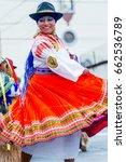 Small photo of Banos De Agua Santa, Ecuador - 29 November 2014: Indigenous Woman Dancer Is Dancing On The Streets Of Banos De Agua Santa, South America Christmas Holiday On November 29, 2014