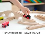 Child Plays With A Wooden Toy...