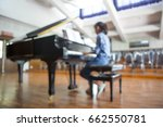 Girl Playing The Piano. Blur...