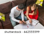 young couple with many debts... | Shutterstock . vector #662555599