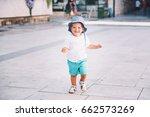 cute little boy run on a city... | Shutterstock . vector #662573269