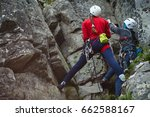two rock climbers work with a... | Shutterstock . vector #662588167