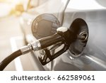 pumping gasoline fuel in car at