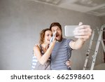 couple at home painting walls ... | Shutterstock . vector #662598601