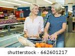 female customers standing near... | Shutterstock . vector #662601217