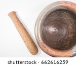 Small photo of Stone mortal and wooden pestle with white background.