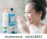 asian women are taking a shower ... | Shutterstock . vector #662618851