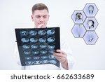 caucasian man doctor holding ct ... | Shutterstock . vector #662633689