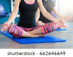 nice couple doing yoga in a... | Shutterstock . vector #662646649