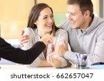 happy couple receiving the new... | Shutterstock . vector #662657047