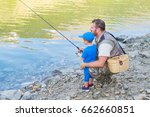 Dad And Son Are Fishing...
