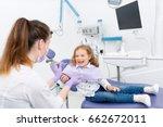 female pediatric dentist medic... | Shutterstock . vector #662672011