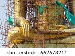 sculpture of a large buddha... | Shutterstock . vector #662673211