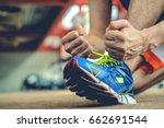 man rope tie shoe run in gym | Shutterstock . vector #662691544