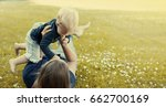 mother and baby playing on the... | Shutterstock . vector #662700169