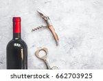 glass wine bottle and corkscrew ... | Shutterstock . vector #662703925