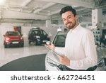 friendly vehicle salesman... | Shutterstock . vector #662724451