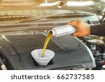 car mechanic replacing and... | Shutterstock . vector #662737585